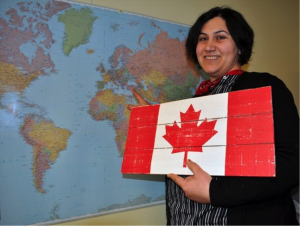 Gokce Saglampolat points out her native Turkey on a world map
